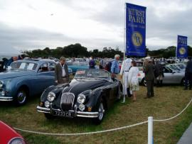 Car Consultant with clients at Goodwood Revival Classic Car event