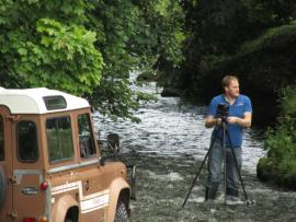Car Consultant photographing Land Rover in River Dart